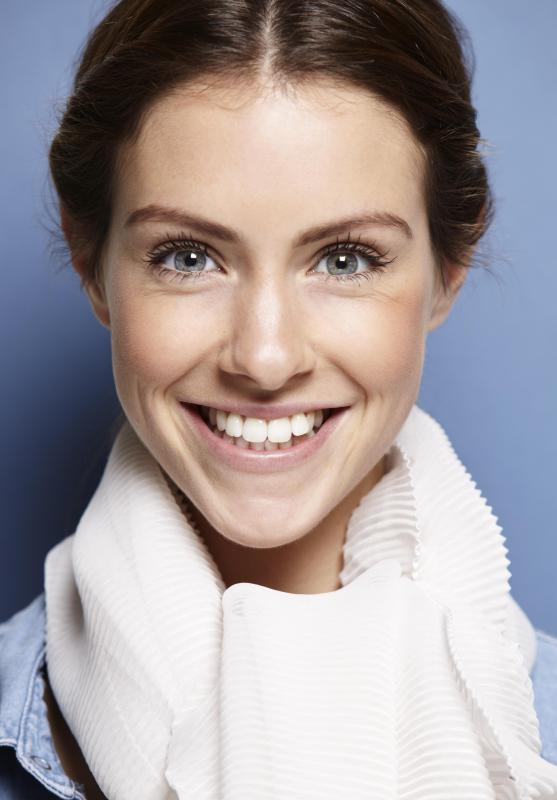 Some people use teeth-whitening strips to obtain a brighter smile.